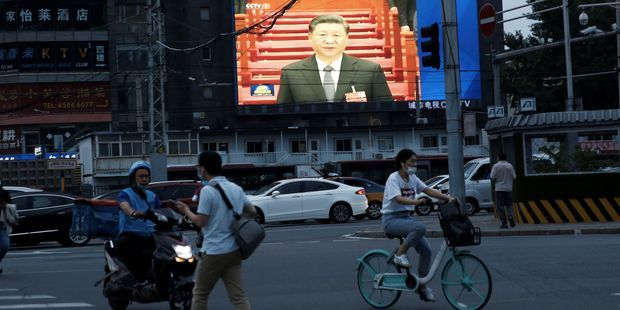 Une image du président Xi Jinping dans un rue de Pékin.